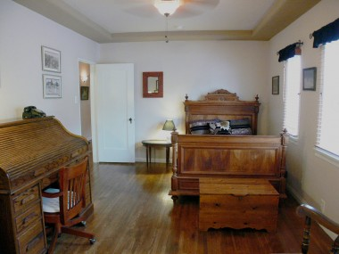 Very large secondary bedroom with walk-in closet, tray ceiling and gorgeous hardwood floors.