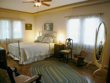 Master bedroom with tray ceiling, walk-in closet and private three-quarter bathroom (a true suite).