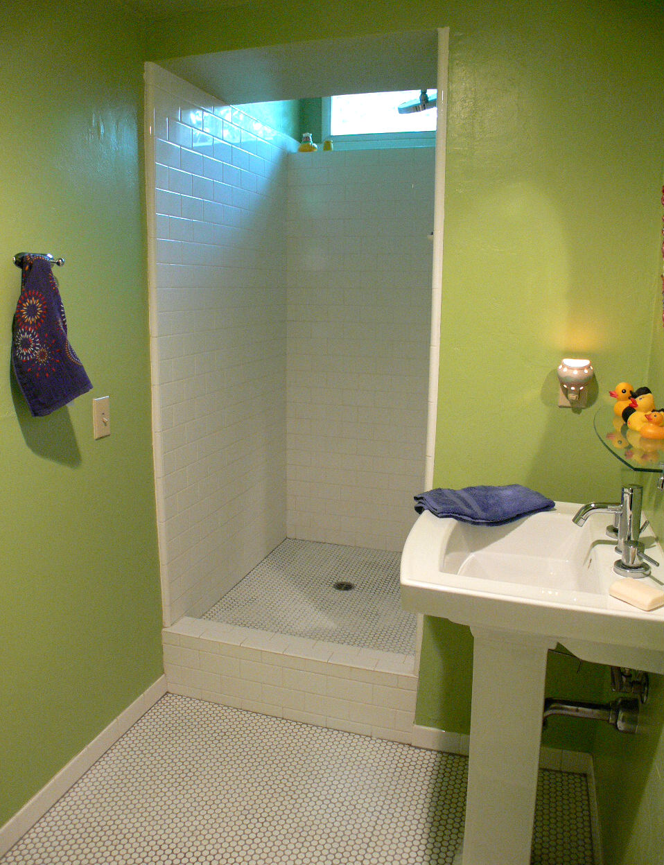 Remodeled three-quarter bathroom adjacent to the family room.