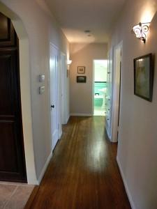 Hallway to bedrooms. Closet on the left has trap door to basement access.