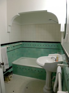Gorgeous hallway bathroom with original tile and newer pedestal sink.