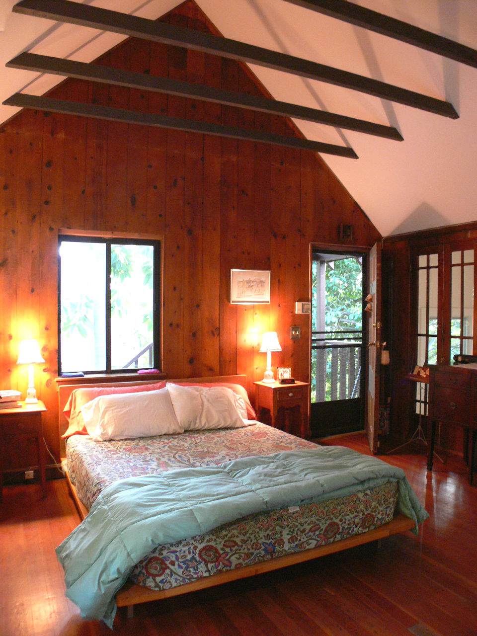 Master bedroom suite with separate entrance and cathedral/beamed ceiling and window seat.