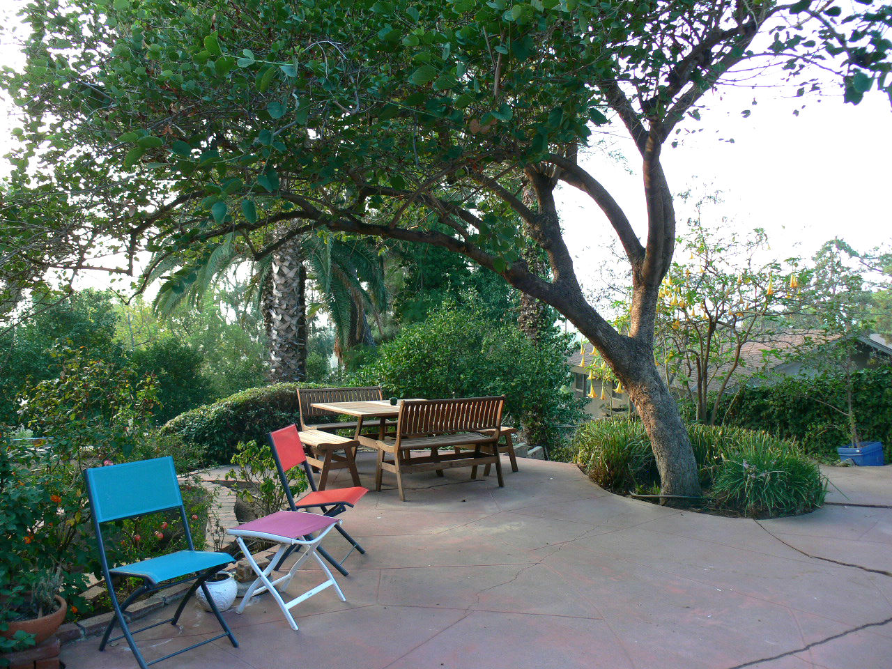 Upper level entertaining area with shade tree and view.
