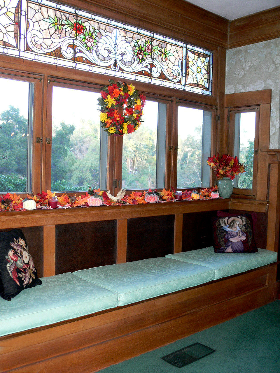 Best Antique leaded glass window above the window seat in dining room was removed from the
