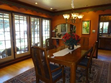 Formal dining room with Bradbury & Bradbury wallpaper adjacent to the crown moulding.