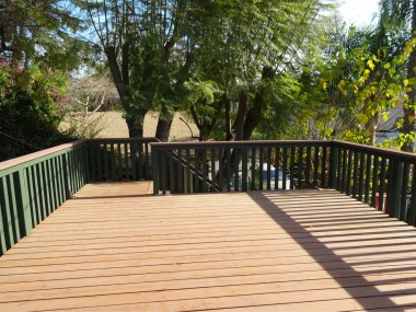 Enormous deck off the master bedroom with stairs to the backyard.