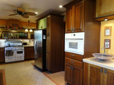 Alternate view of remodeled kitchen with wet bar sink and convenient pass-thru to formal dining room.