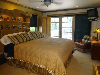 Spacious master bedroom with French doors leading to enormous deck with stairs to the yard below!