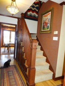 Lovely stairway leads to three upstairs bedrooms and a full bathroom.