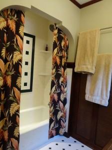 Upstairs remodeled bathroom shower enclosure.