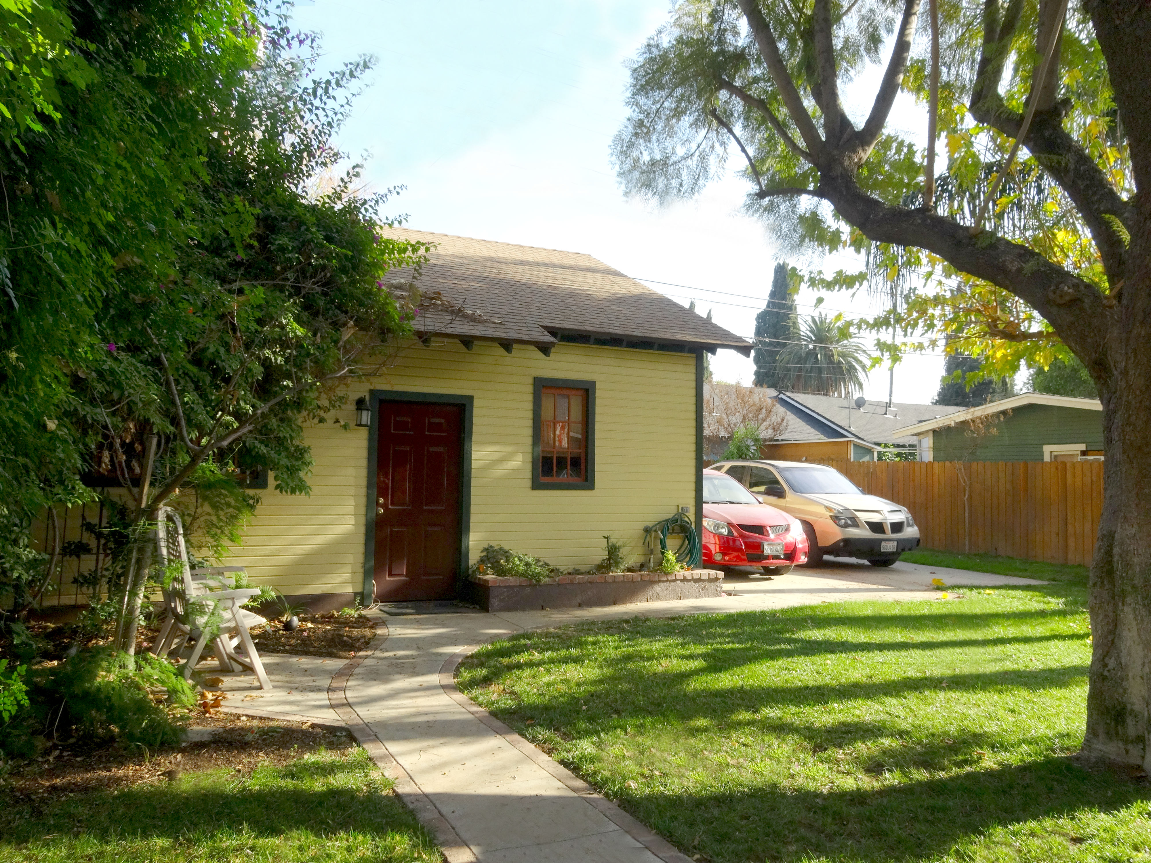 Portion Of Backyard With Mature Shade Tree And Side View Of The Detached 2  1/