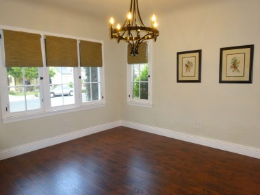 Spacious formal dining room with  chandelier and lots of windows.