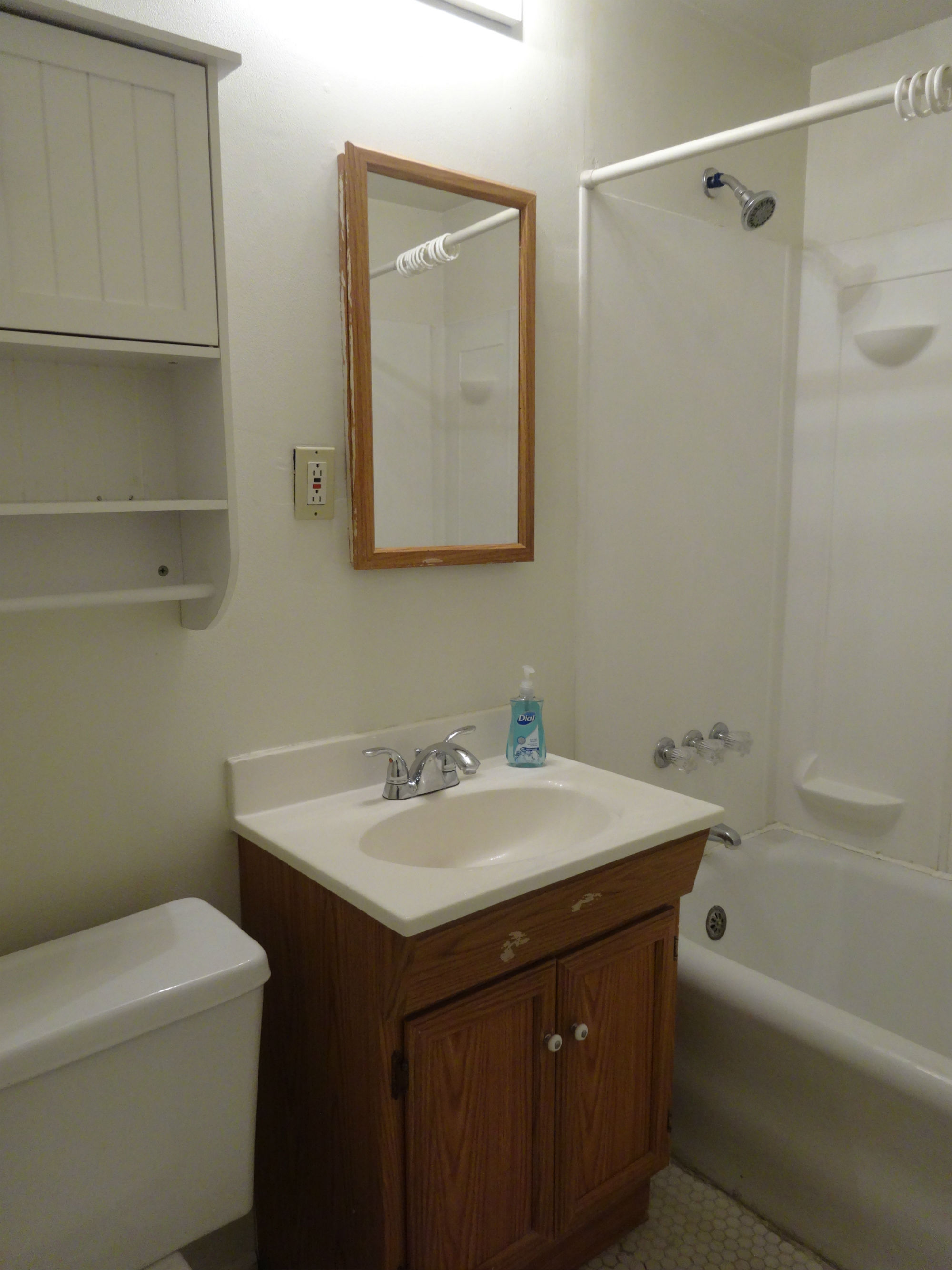 Right side bathroom with newer vanity and toilet.