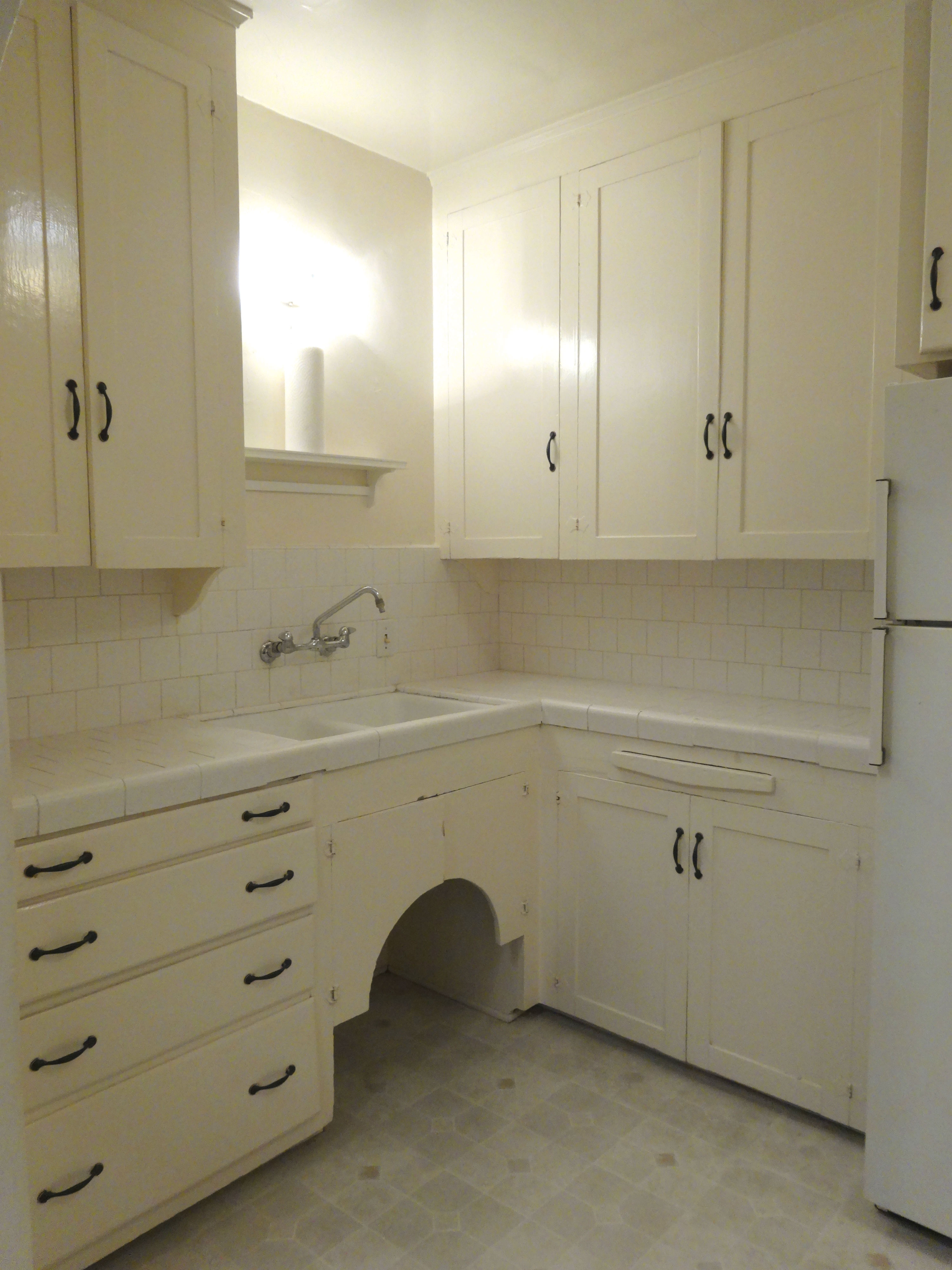 Elegant Lots of cabinetry in kitchen even more storage above gas stove
