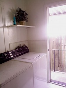 Laundry room with space for side-by-side washer/dryer.