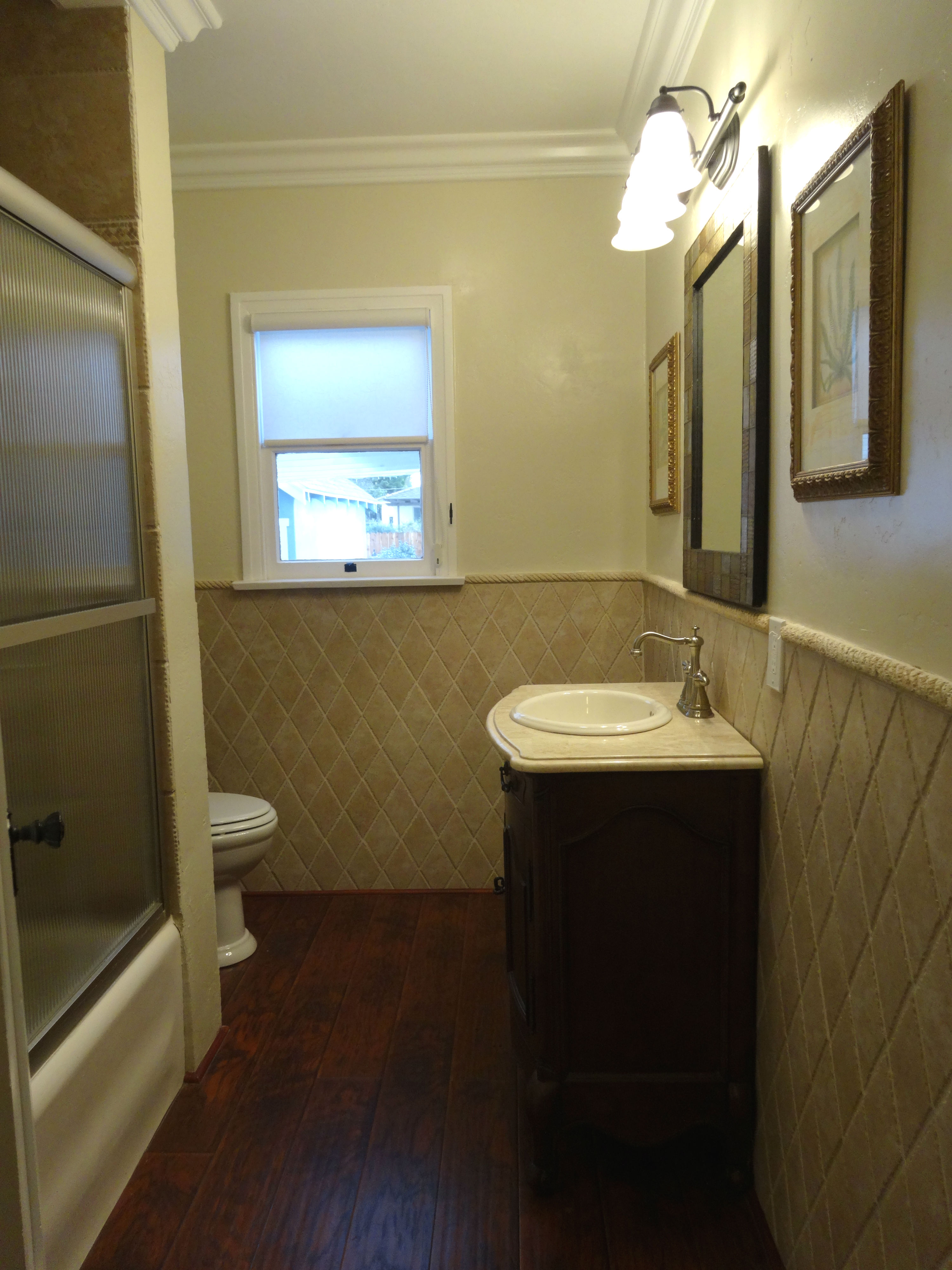 Fancy Alternate view of hallway bathroom including fully tiled shower enclosure with glass doors