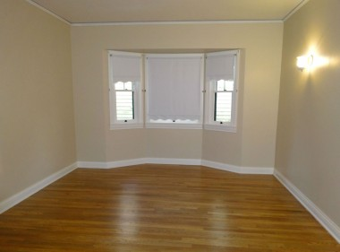 One of three spacious bedrooms, all with refinished original hardwood floors!