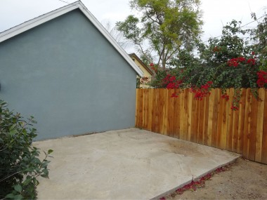 Gated area behind garage with slab for  any number of uses (dog run, storage,  shed, pool house, etc.)