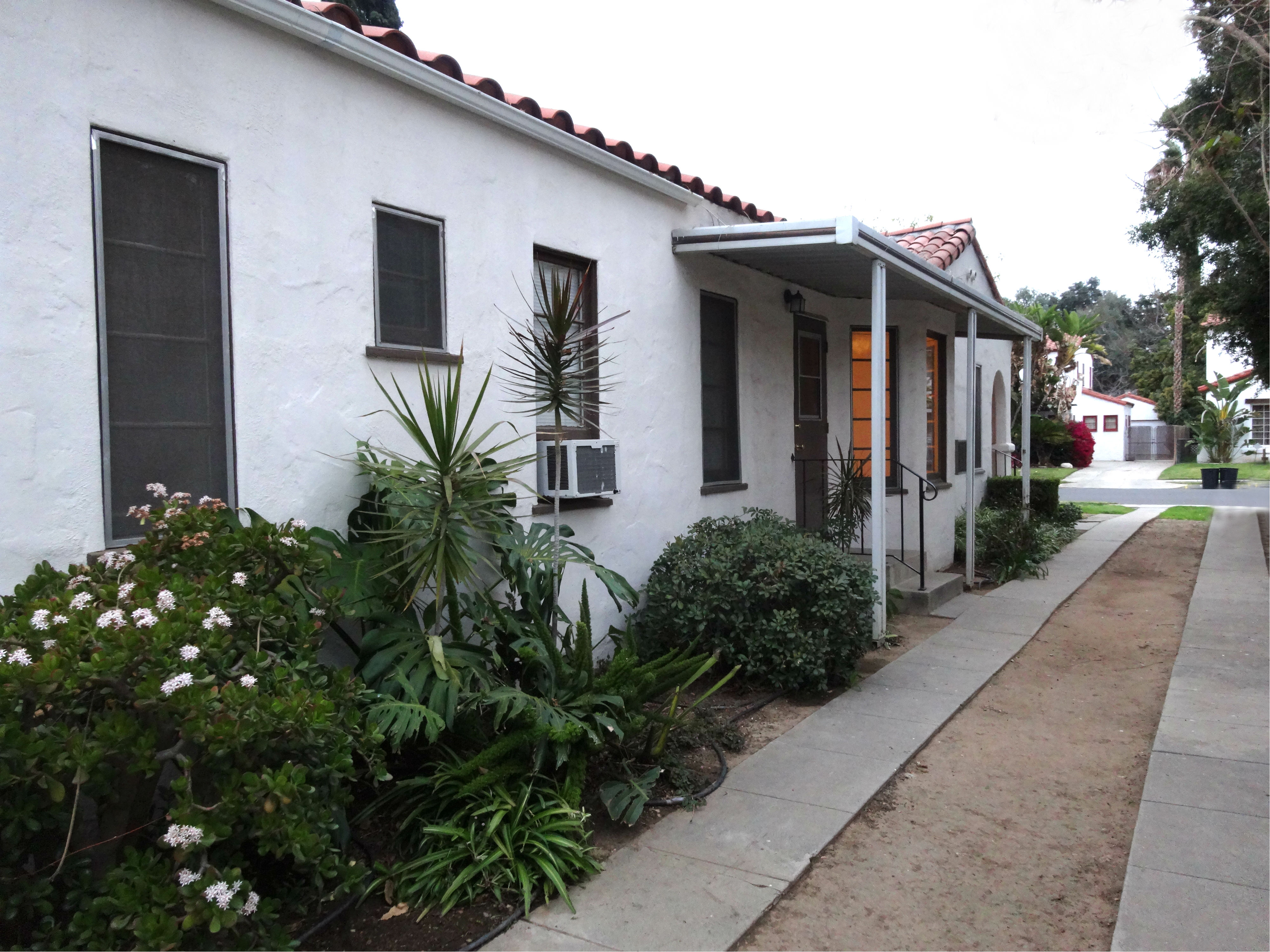 """Long """"Hollywood"""" driveway leading to the 2-car garage."""