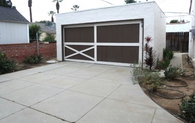 Two-car garage which is divided into two private parking spaces for tenants.