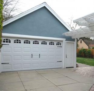 2-car detached garage with newer  roll-up door.