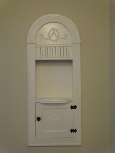 Original charming built-in alcove in  hallway.