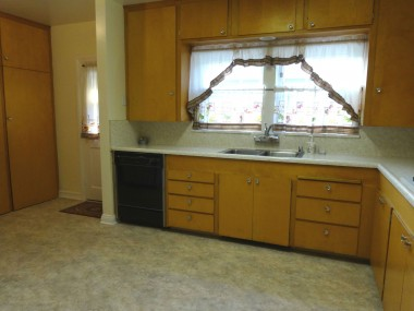 Spacious kitchen with original cabinetry, but newer dishwasher, new garbage disposal and new flooring. Gas appliances and room for preparation island.