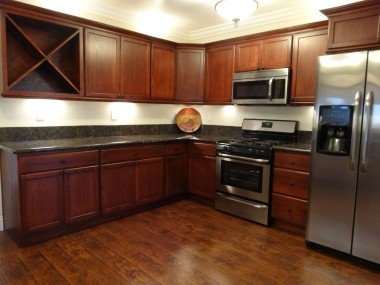 Alternate view of remodeled kitchen  with stainless steel stove/range and  built-in microwave.