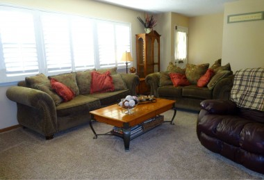 Living room with newer carpeting and newer plantation shutters!