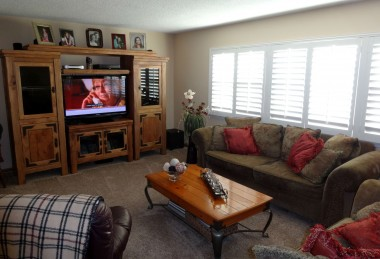 Alternate view of living room with gorgeous plantation shutters and room for sectional sofa!