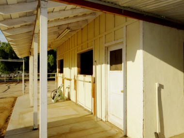 2-stall barn (with plumbing and electrical) and tack room.