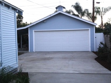 2-car garage with newer automatic roll-up door.