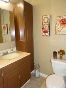 Hallway bathroom with tile floor and  tub