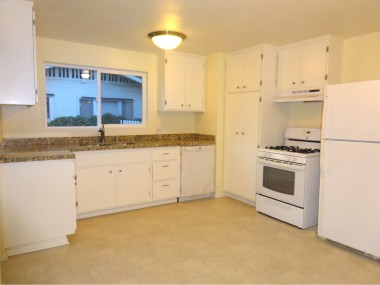 Huge eat-in kitchen with brand new granite counter tops, brand new dishwasher, and gas stove and refrigerator.