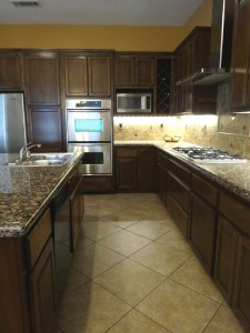 Gorgeous remodeled kitchen with  stainless steel appliances and tile back  splash.
