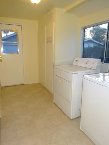 Indoor laundry room with washer/dryer included.