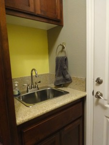 Convenient sink in laundry room.