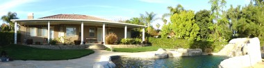 Panorama of elegant backyard with saltwater pool, spa and waterfall!