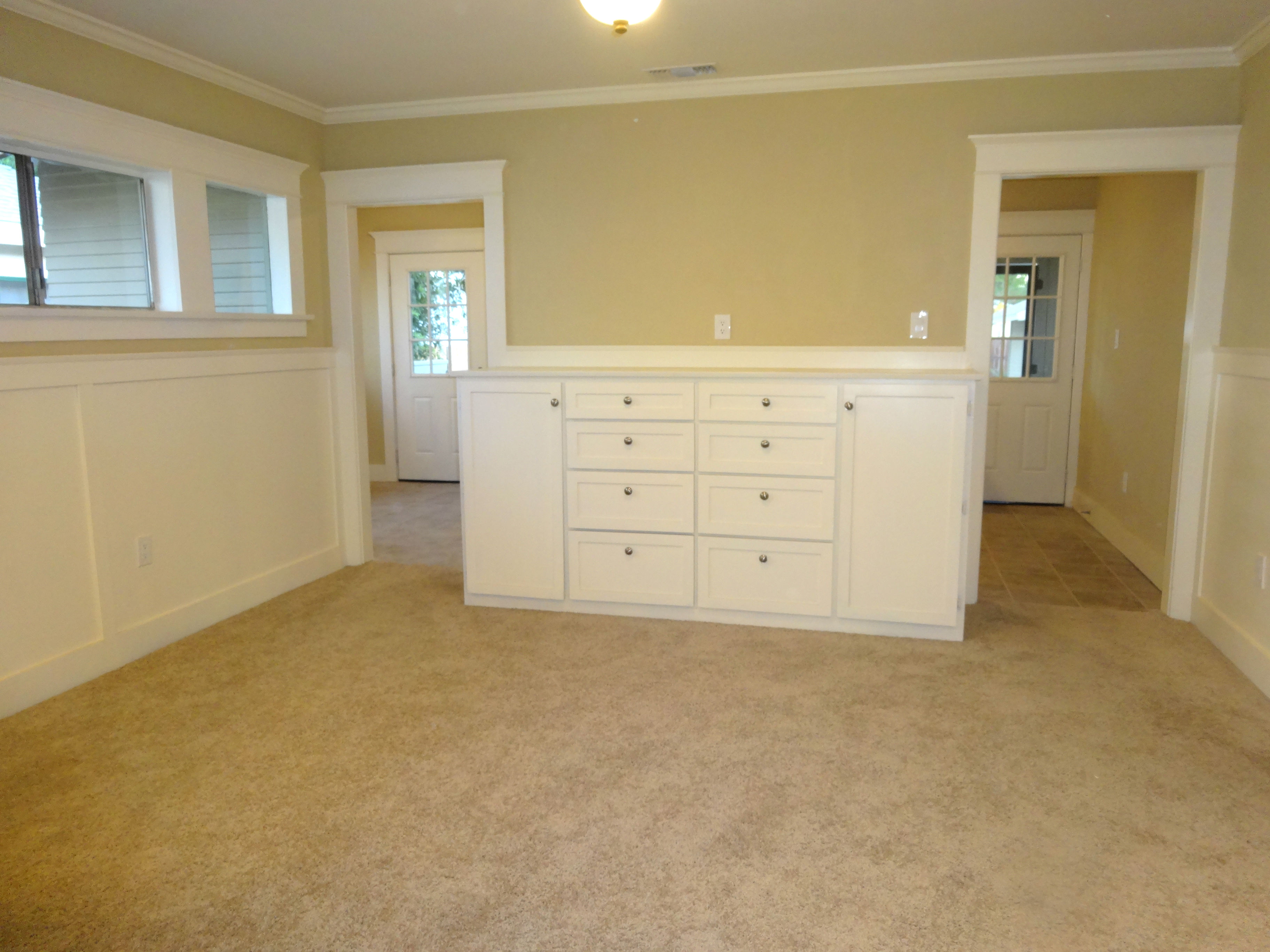 Formal dining room with built-in hutch.