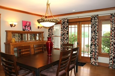 Large formal dining room with French doors leading to private side patio.