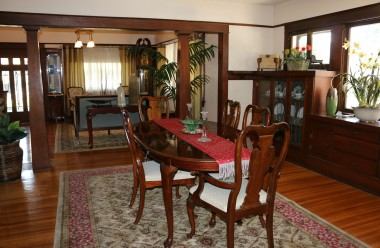 Formal dining room with gorgeous original hardwood floors and original built-in hutch.