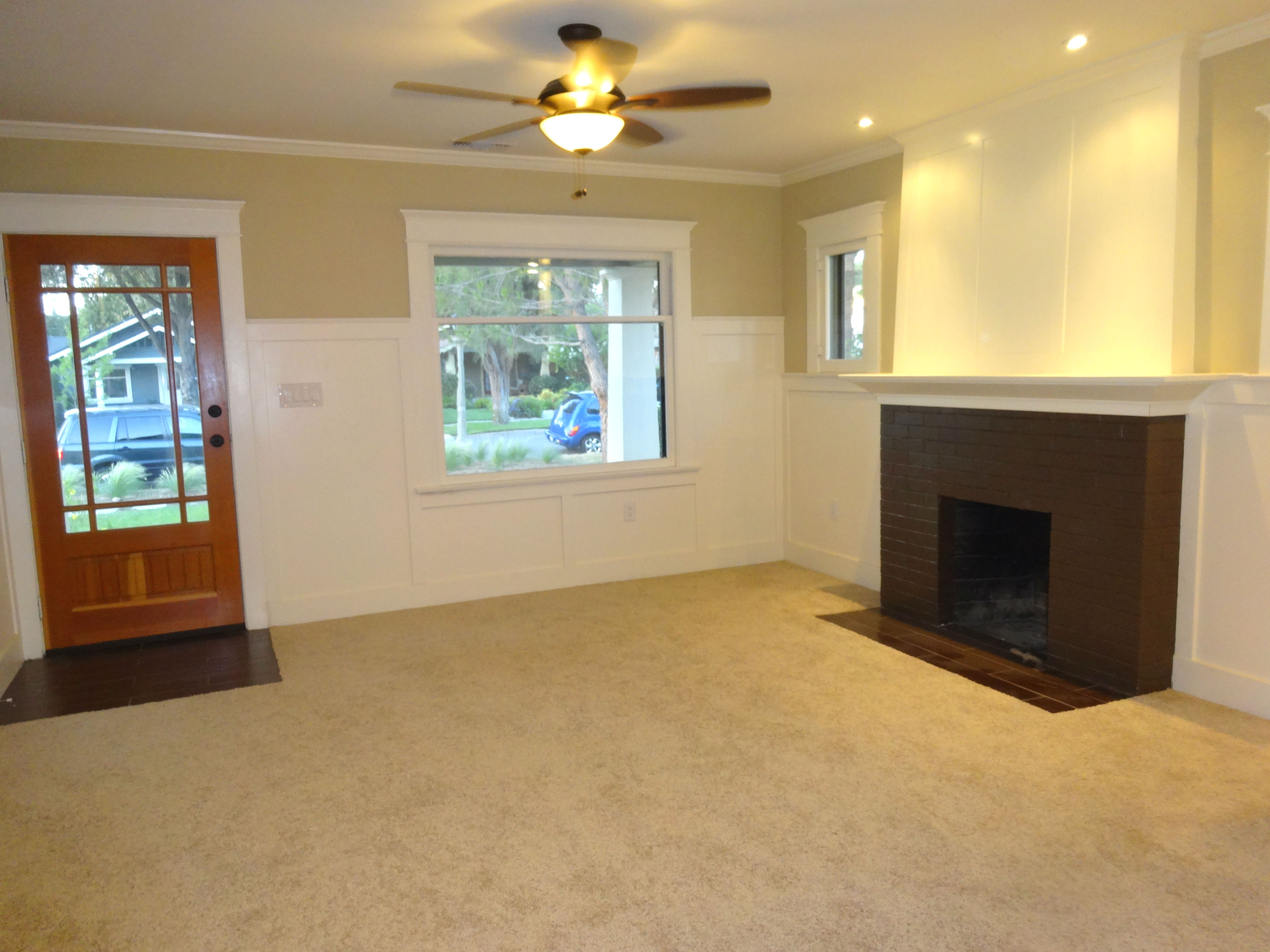 Front entrance and wood-burning fireplace. Recessed lighting, ceiling fan, new carpet.
