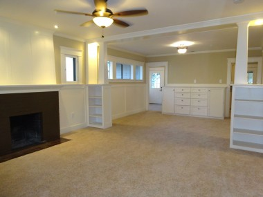 Living room and formal dining room. Built-in display shelves too!