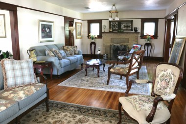 Gorgeous formal living room and sitting area with fireplace and original hardwood floors, fixtures and windows! Doesn't get any more charming than this!