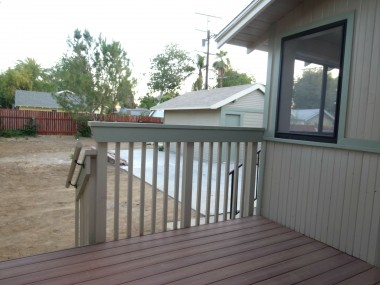 New deck leading to spacious pool-size backyard with alley access and 1-car detached garage.
