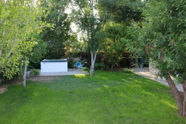Private pool-size back yard, currently with above-ground spa, fruit trees. and even a shed behind the casita.