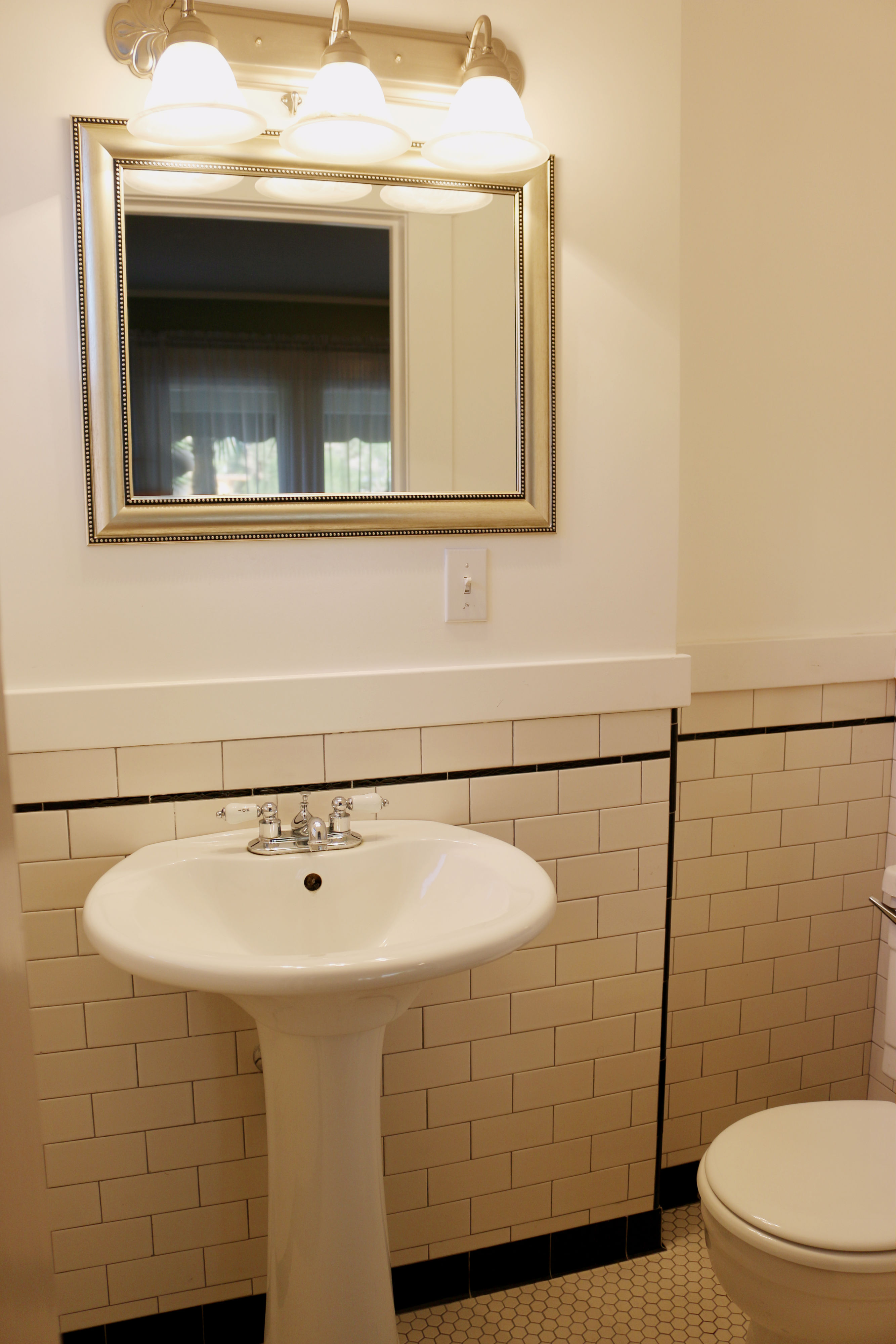 Remodeled Half Bath In Front Bedroom With Subway Tile And Pedestal Sink.