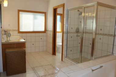 Huge upstairs bathroom with tile flooring, privacy pocket door for commode (with phone), separate shower, and separate tub.