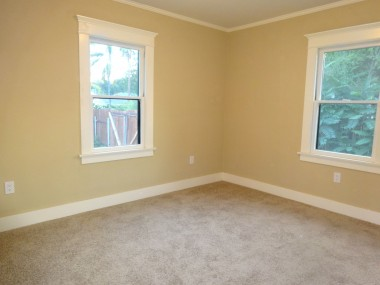 Back bedroom with new carpet, light fixture, paint, etc.
