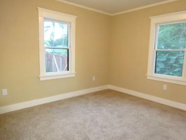 Back bedroom with new carpet, light fixture, paint, etc.